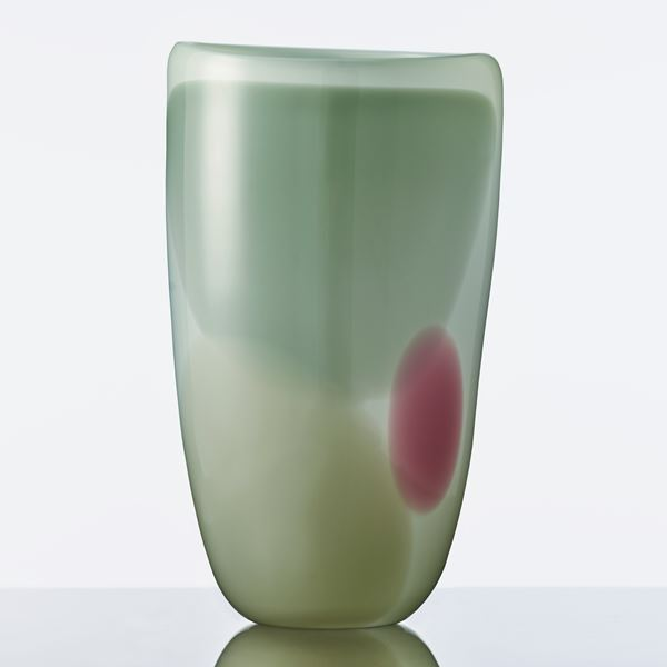 modern glassware vessel sculpture in shades of green with small purple patch