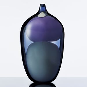 blown glass vase sculpture in shades of blue purple and grey