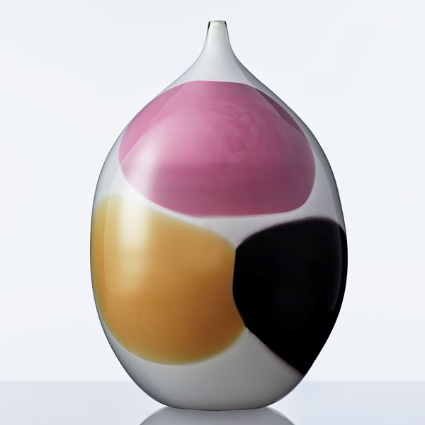 white glass vase sculpture with large pink orange and black dots