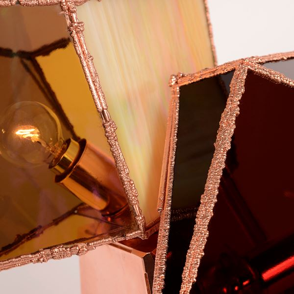 table light with copper base and angled shaped glass in gold pink and ruby