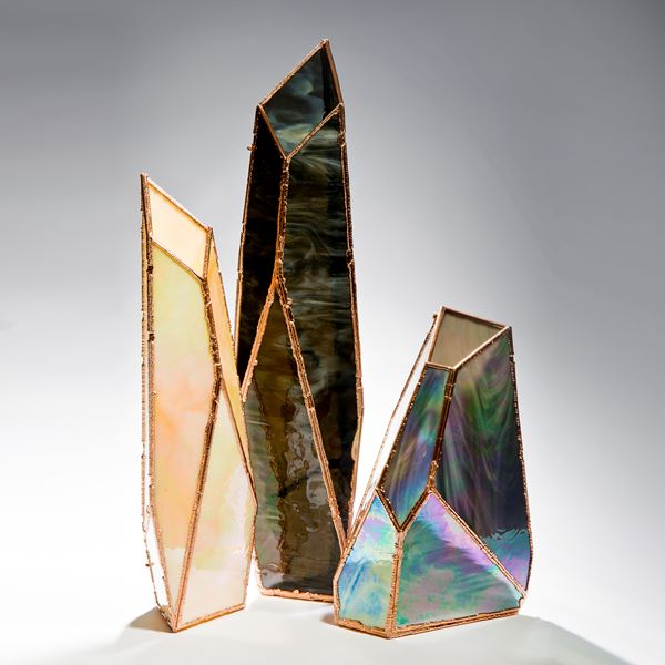 three crystal shaped glass art vases in oil coloured glass and copper frame