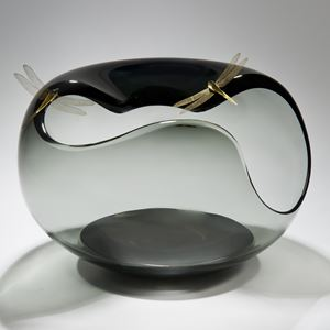 abstract clear and grey glass art bowl shape with wide open edges adorned by gold plated dragonflies
