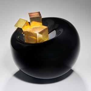black modern rounded art glass sculpture with gold glass cubes in centre