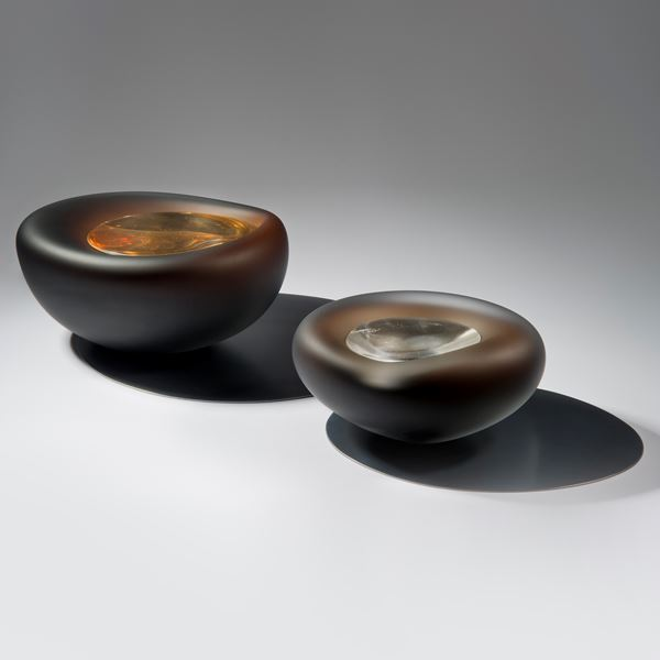 dark brown pebble shaped glass bowl with crystal like glass centre