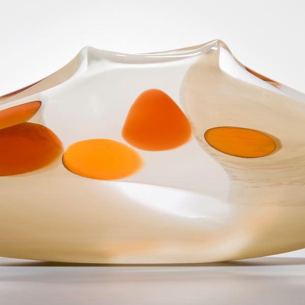 short art glass vase in cream with orange circles