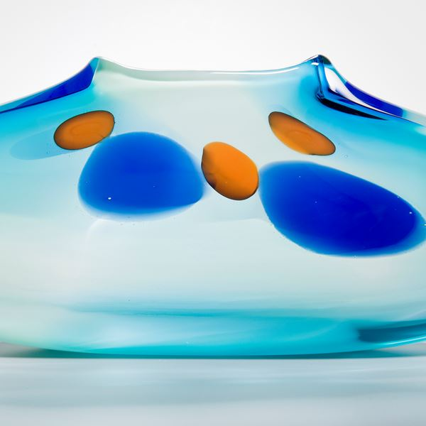 abstract turquoise glass art vase with blue and orange dots
