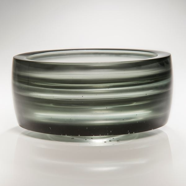cast glass tyre-shaped sculpture in black and light grey