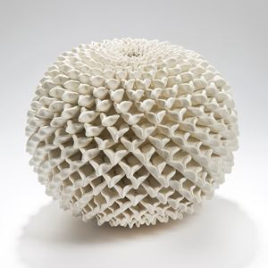 a round ceramic sculptured vessel with 3d patterned chrysanthemum in white