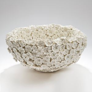 white porcelain bowl sculpture in the shape of many small daisies in white