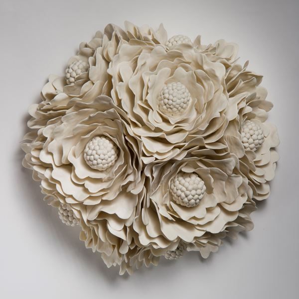 wall hanging ceramic artwork of flowers in white