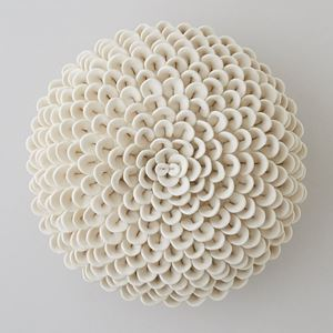 white porcelain sculpture of dahlia flowers arranged in sphere
