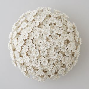 white porcelain sculpture of daisies arranged in sphere