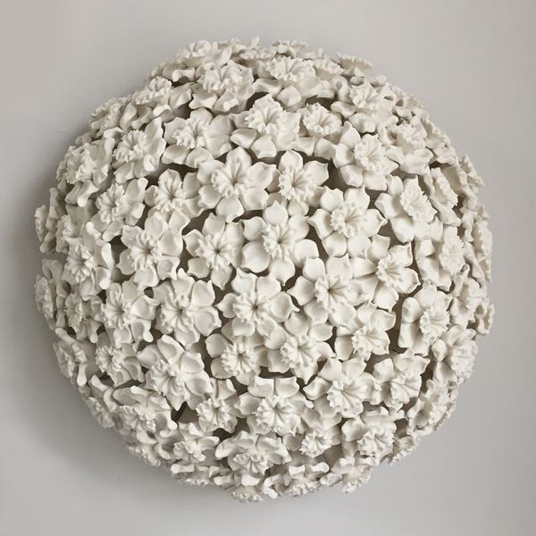white porcelain art sculpture of daffodils arranged in sphere