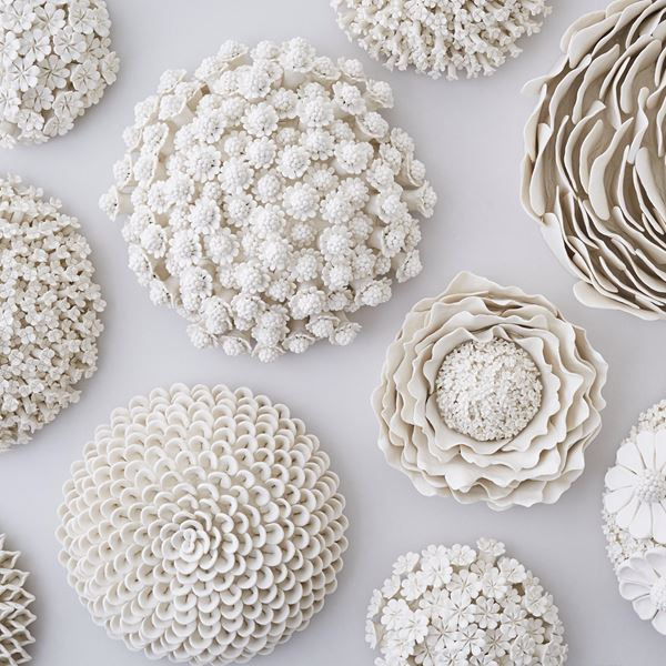 white porcelain art sculpture of daisies arranged in sphere