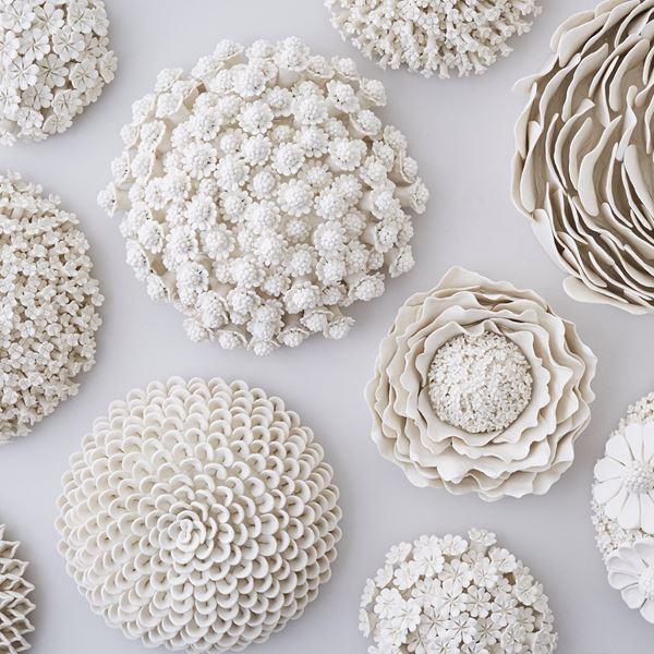 white porcelain sculpture of dahlia flowers arranged in sphere