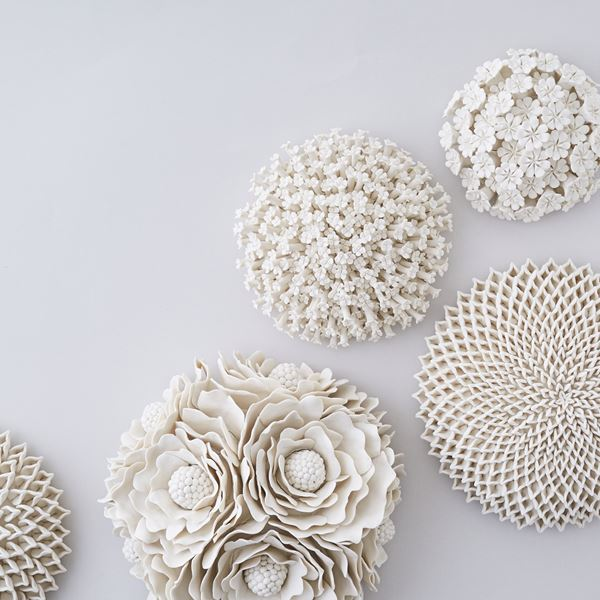 porcelain art sculpture of flowers arranged in sphere