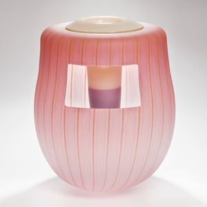 soft peach coloured glass art vessel sculpture with white window-like motif