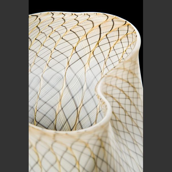 white glass art basket with faint gold pattern