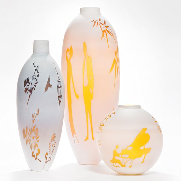 cameo glass vases in white with bright orange and red motifs