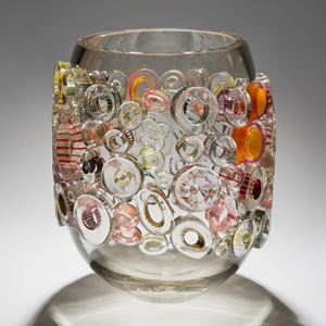 clear and grey wide handblown glass vase with circular additions in clear orange and yellow