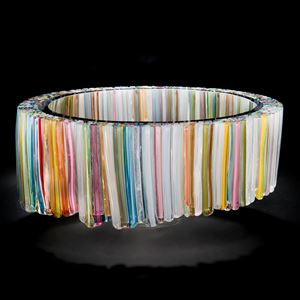 art glass sculpture of neon coloured shards arranged in hollow circle
