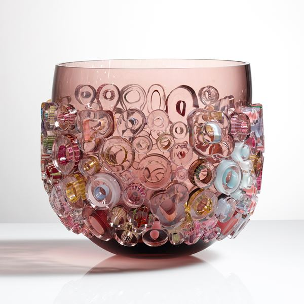 light brown glass vase sculpture with external lightly coloured donut shapes