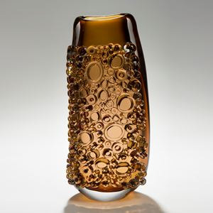 dark amber tall glass vessel sculpture with external circular crystals