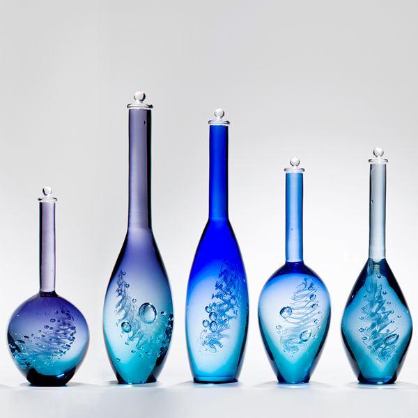 series of five blue art glass bottle sculptures