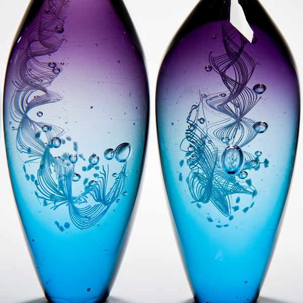 five handblown glass vase sculptures with long necks in pink purple and blue