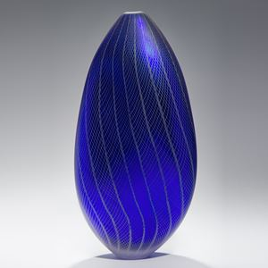 tall oval shaped dark blue vase sculpture with grey patterned exterior