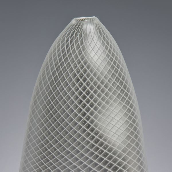 tall abstract blown glass vase in light grey with cross patterned exterior