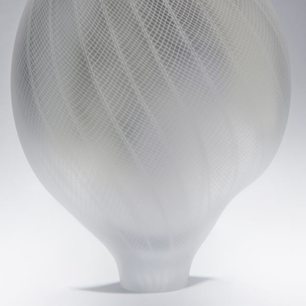 modern art glass vase ornament in light grey with thin bottom and decorative cross-patterned exterior