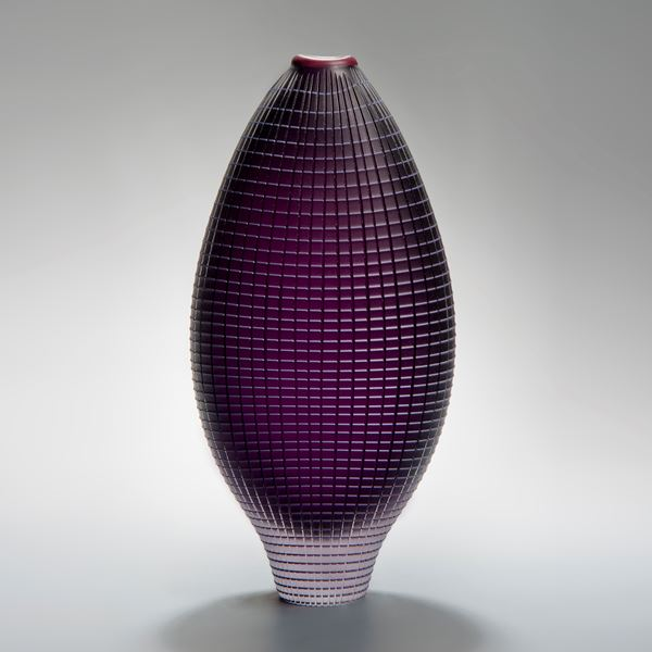 tall and wide handblown glass vase in dark purple with chequered external pattern