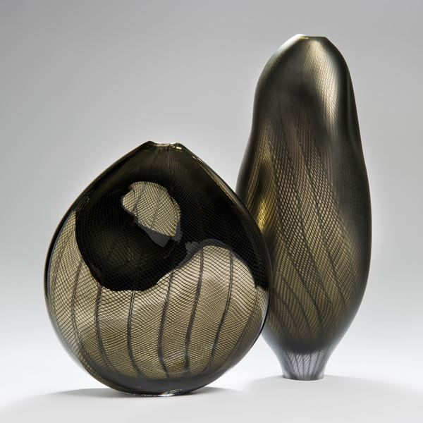 handblown minimalist glass teardrop shaped sculpted vessel in dark gold and black with wave checked external pattern