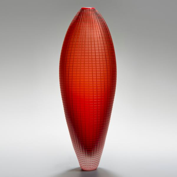 tall oblong blown glass vase sculpture in orange and red with subtle checked pattern
