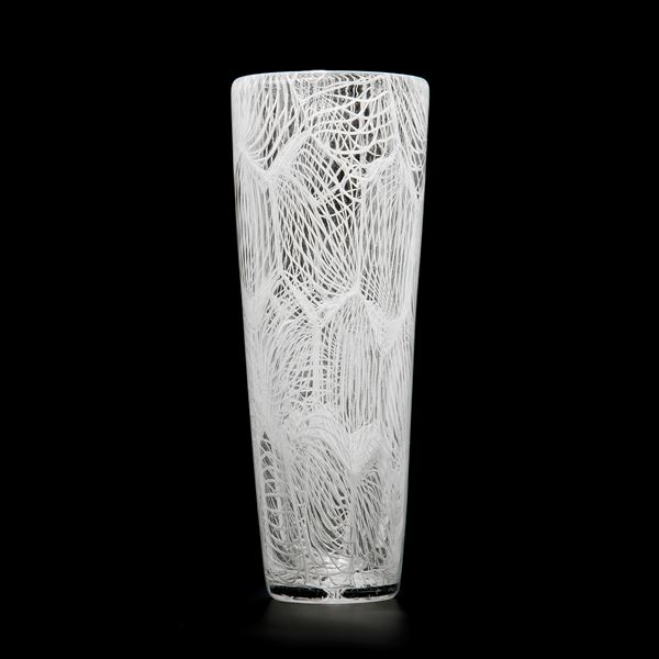 tall clear glass sculpture with external white pattern