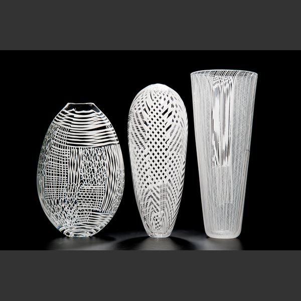 tall clear glass vase sculpture with white pattern