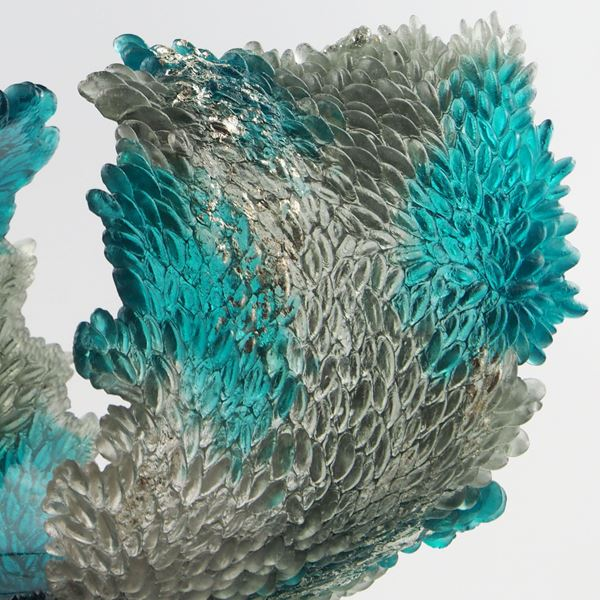 turquoise and clear art glass concave sculpture of wave shape