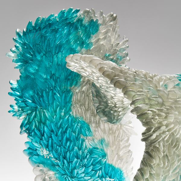 modern art glass sculpture of curled form in turquoise and clear glass