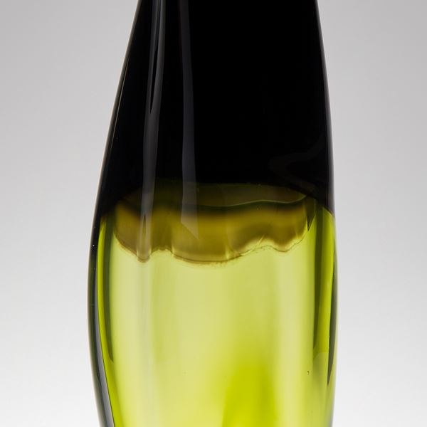 tall sculpted glass vessel in black and lime