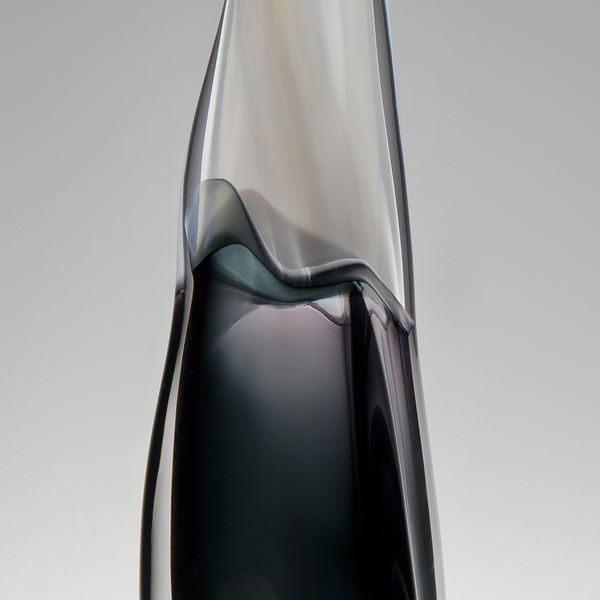 tall thin blown glass vase with black lower and clear upper halves