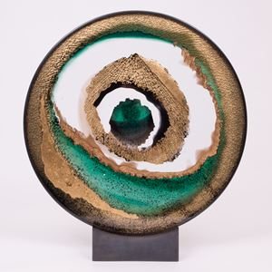round art glass sculpture of eye like shape in white sand and green