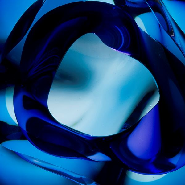 contemporary abstract art-glass sculpture of vug in light and dark blue