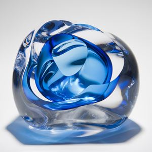 abstract modern glass sculpture of a vug in clear and light blue colours