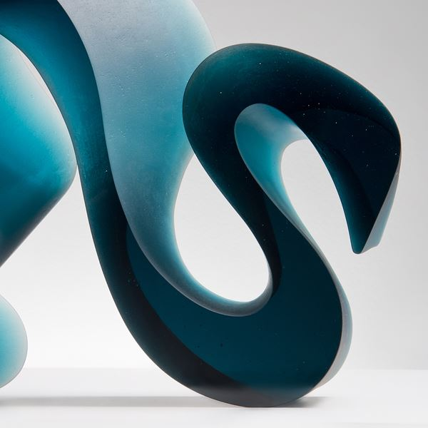 abstract contemporary glass art sculpture of a squiggly line in jade