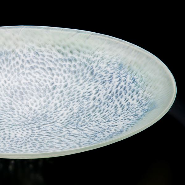art glass sculpted tray in white with faint light blue speckles