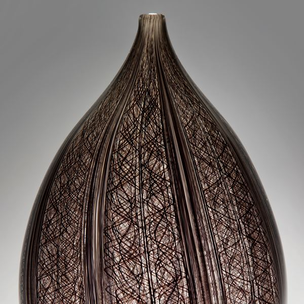 sculpted art-glass vase with wide base and narrow top with patterned exerior