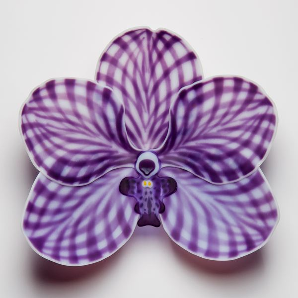 hand made fused glass sculpture for wall mounting of viola flower in chequered white and purple