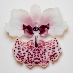 sculpted glass art of exotic flower in white with pink speckles and purple detail