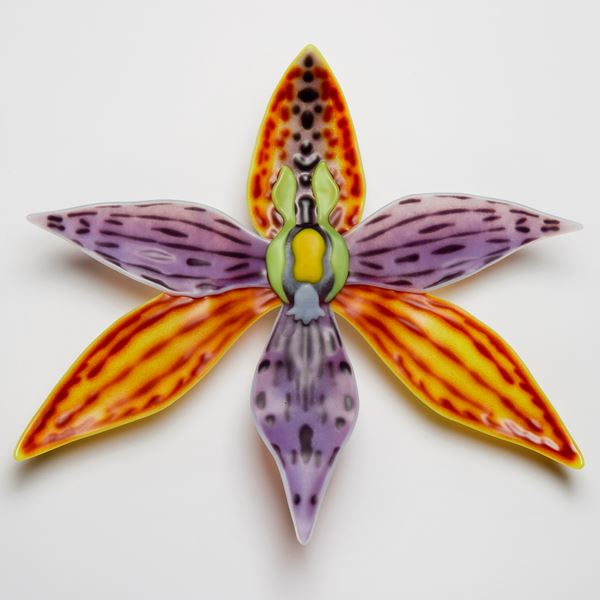 colourful glass art sculpture of flower in star shape
